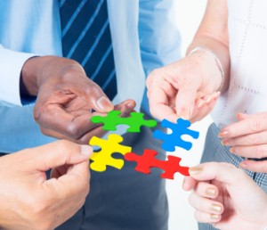Group business people connecting jigsaw together